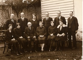 Family Photo of Walter Scott Booley (seated, third left) and sons and daughters. My grandmother Jean Booley is seated second left.
