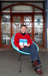 Author Carol Altmann relaxes in front of her favourite Warrnambool icon Swintons. picture by Jenny Fawcett 2014