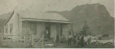 Lizzie Journeaux c1888 holding her infant daughter Mary Jane, on the verandah of her new home at Tinui built by her carpenter husband Leonard Bushby who died soon after this picture was taken. photo courtesy of Corlette family