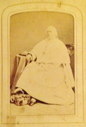 "A photo of Pope Pius 1X is among the very first of photos in Lizzie Journeaux's album and one of the few identified, accompanied by a 6 verse prayer ""God Save The Pope"" written on the back. Photo courtesy of Corlett family"