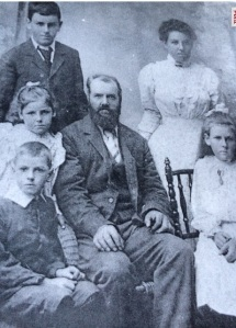 Thomas Chettle as a young boy (seated left) with his father 'Henry' , brother 'Harry' and sisters Eleanor (standing), Gertrude 9seated right) and Sarah. picture courtesy of Glenyce Hester family collection 2015