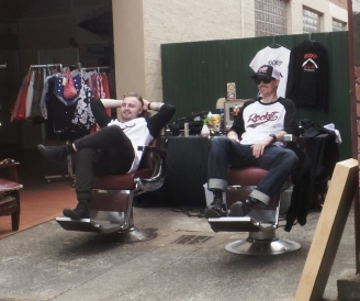 Barbers Blake Churchill and Evan Rolton e from the 'Rockit Barber Shop' of Collins Street Melbourne. take a break. Camperdown Cruise Rockabilly Weekened. 25 Oct. 2015, picture by Jenny Fawcett